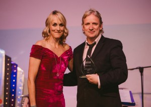 Roddy Fraser receiving award for charity fundraising